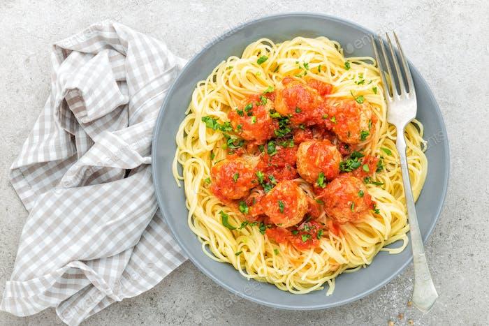 Pasta, vermicelli with meatballs in tomato sauce. Italian cuisine