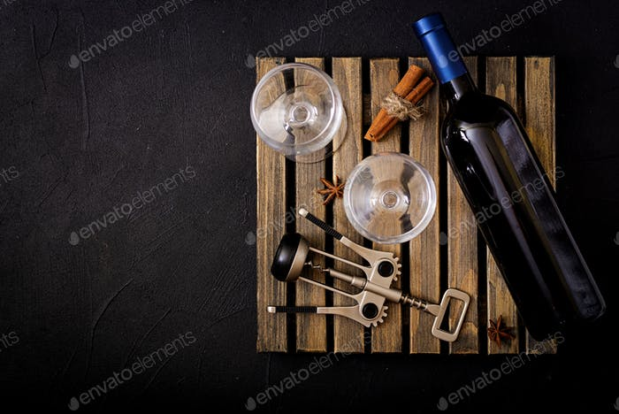 Bottle of dry white wine and a glasses. Flat lay. Top view.