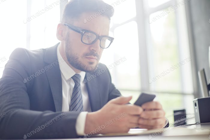 Bearded Businessman at Workplace