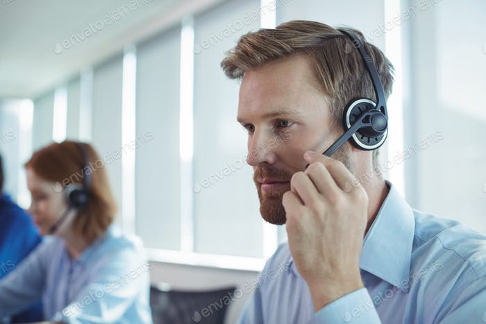Close up of businessman using headset