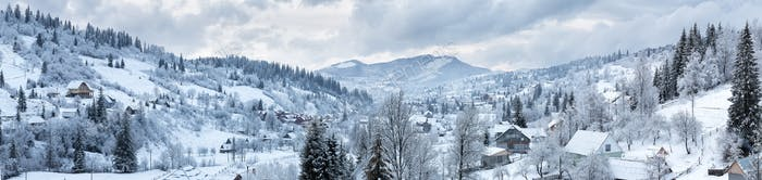 Panorama of the village in the winter mountains
