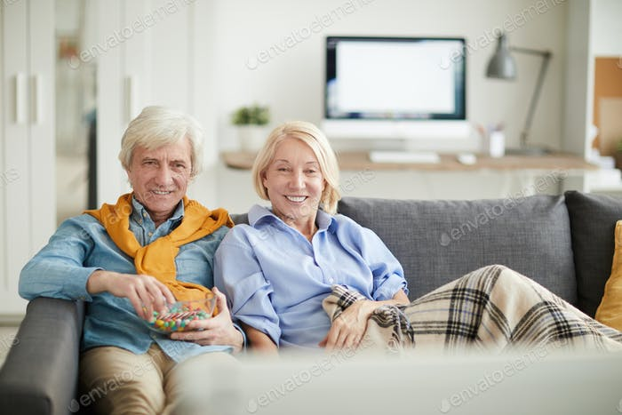 Modern Senior Couple Watching TV