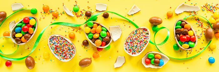 Flat Lay of Sweet Easter Eggs on Yellow Background. Web Banner