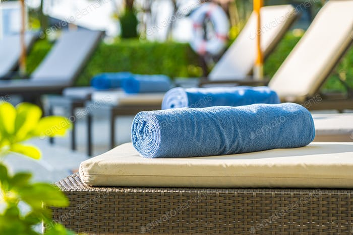Towel on deck chair around swimming pool