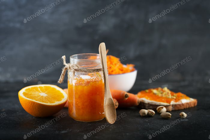 Carrot Jam with orange juice on a black background