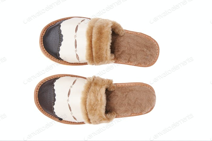 Leather neat slippers on a white.