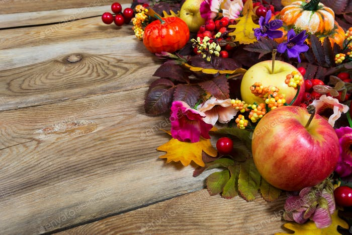Thanksgiving centerpiece with apples, fall leaves, pink and purp