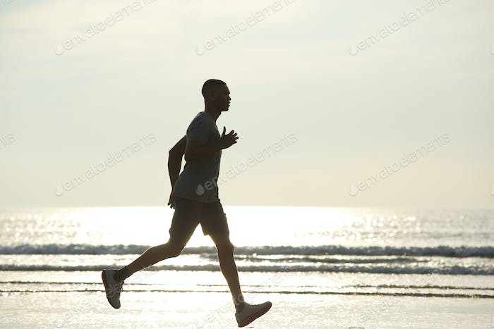 African american man running on beach