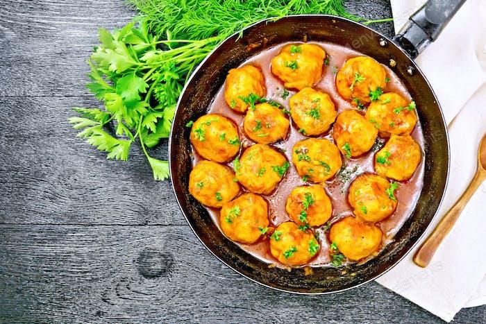 Meatballs in pan on black board top