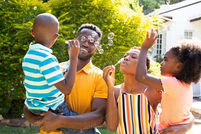 African American family spending time together in their garden.