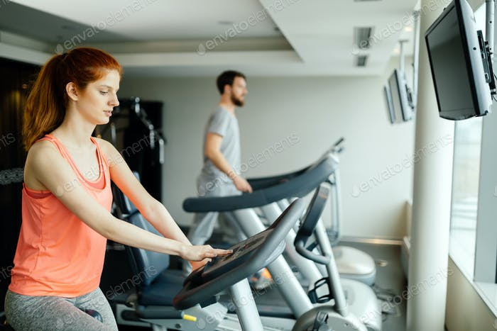 People cardio exercising in gym