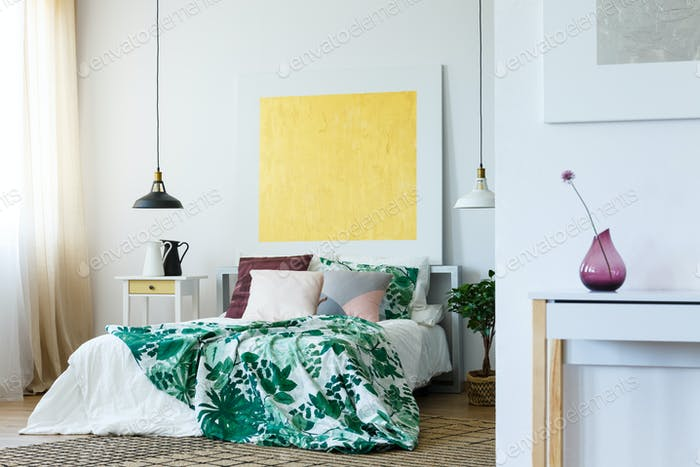 Trendy bedroom with painting