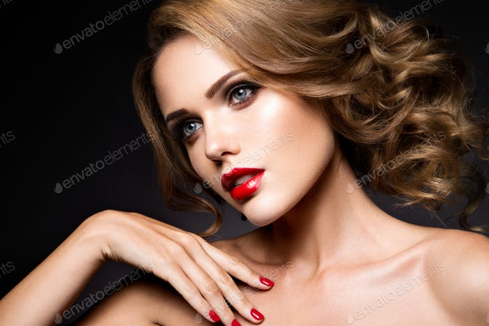 Close-up portrait of beautiful woman with bright make-up