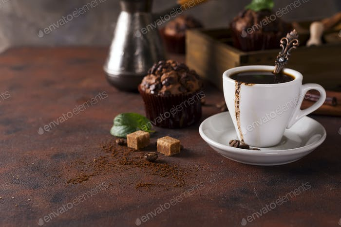 Thumbnail for Cup of coffee with cooffee beans, wooden box with grains of coffee and spices, cupcake