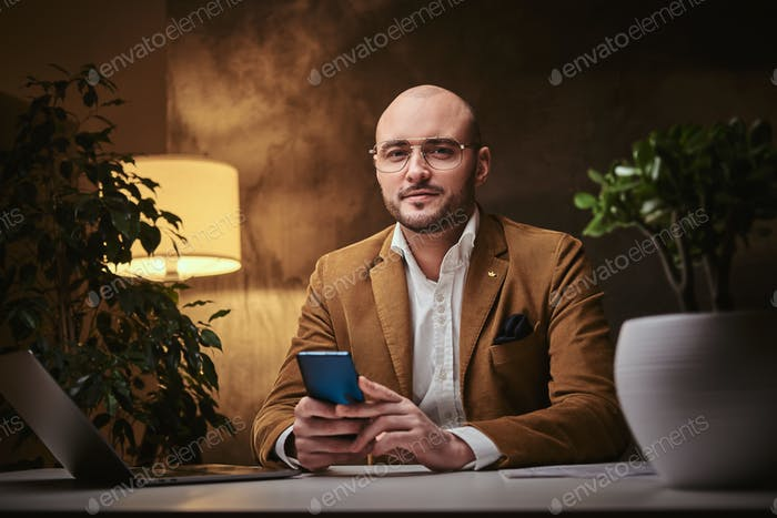 Confident european handsome businessman sitting in the office