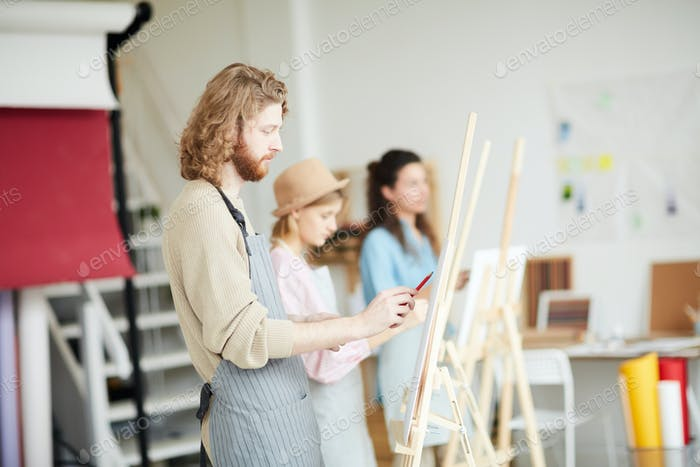 Painter by easel