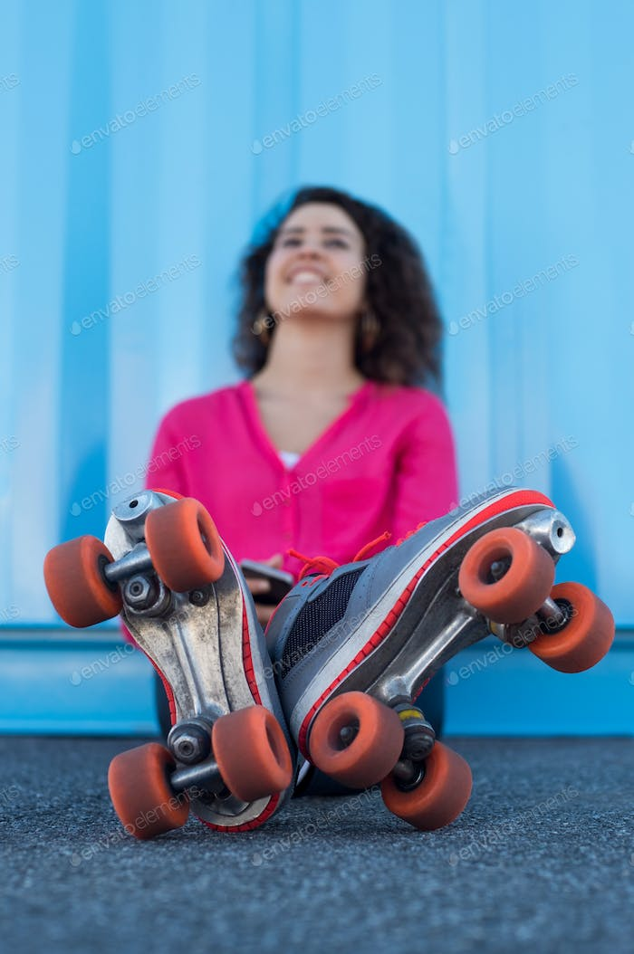 Young woman with rollerskates