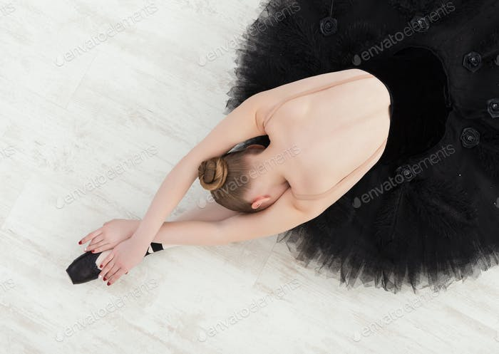 Graceful Ballerina stretching, ballet background, top view