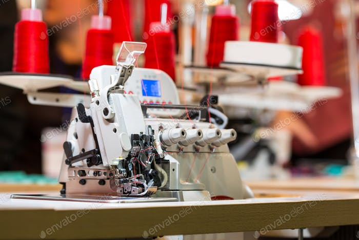 Overlock machine on sewing factory, nobody
