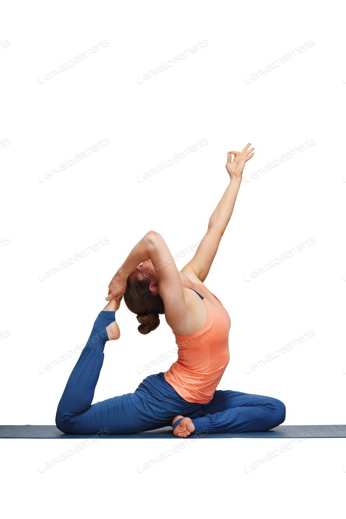 Woman doing Hatha yoga asana Eka pada rajakapotasana