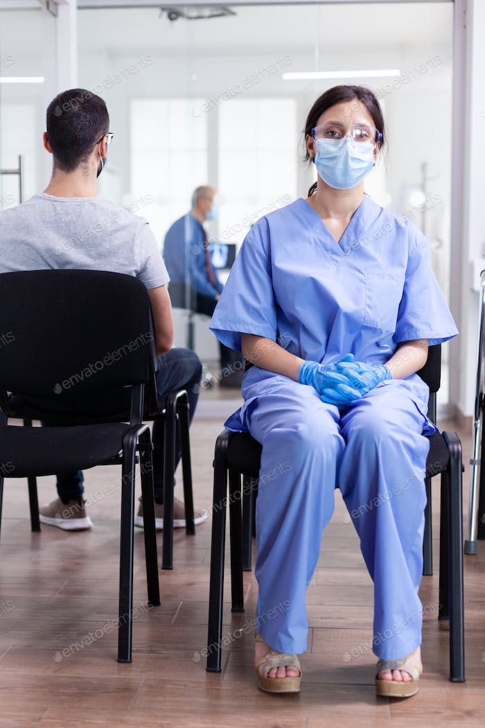 Exhausted assistant in hospital