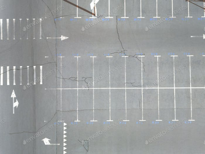 Aerial view of many empty parking spaces with markings summer day . Top view
