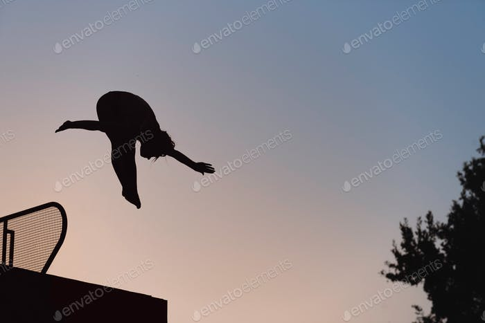 Jump into the pool in dusk