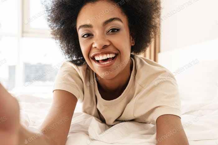 Happy cheerful young african woman