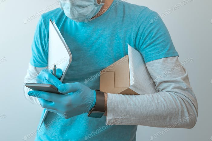 Delivery man with protective clothing using smartphone