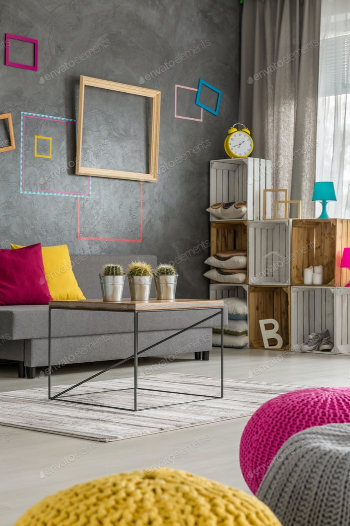Colorful poufs in modern room