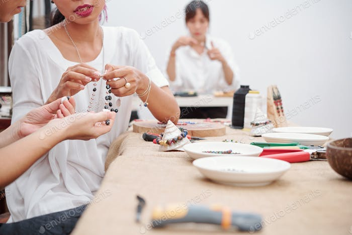 Women making beauticul necklace