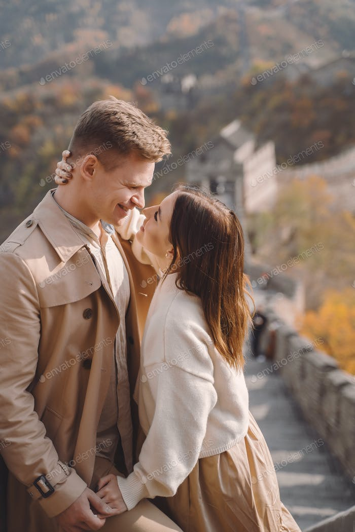 beautiful young couple showing affection on the Great Wall of China