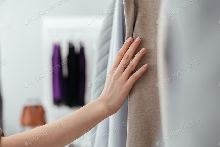 Female hand choosing dress