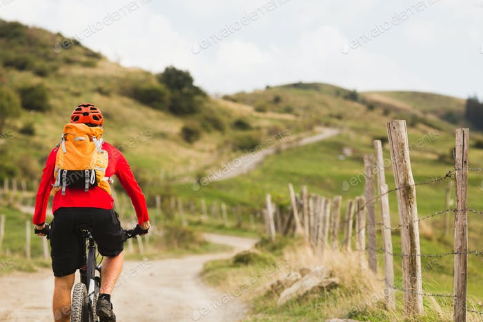 Biker cycling in beautiful mountains