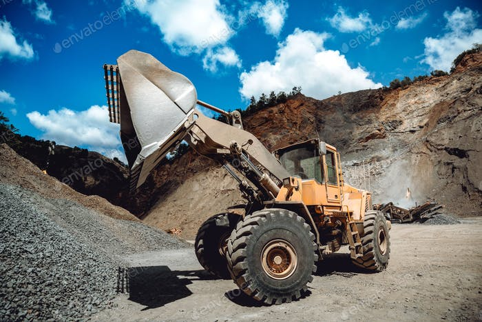 Industrial heavy duty wheel loader working on construction site