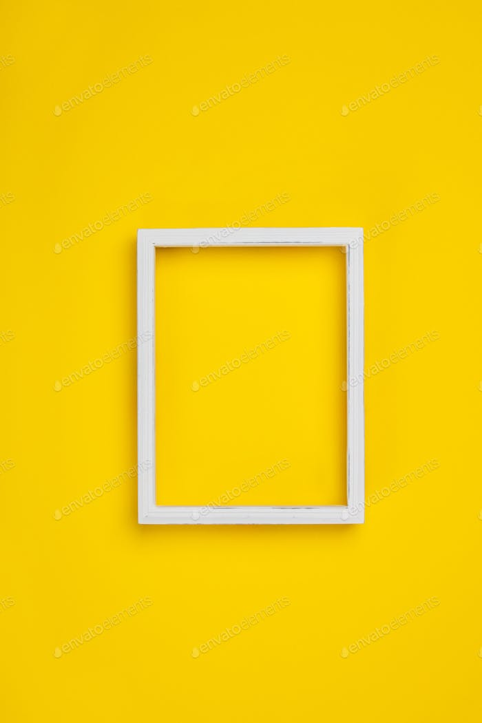 White vintage frame on yellow background, space for text