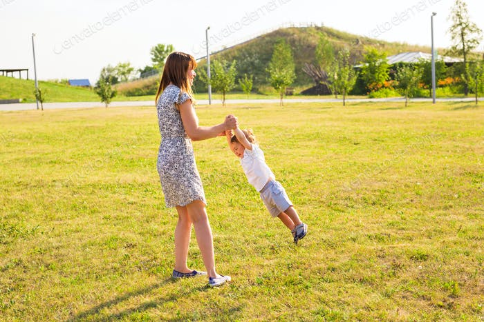 mother and son playing on nature