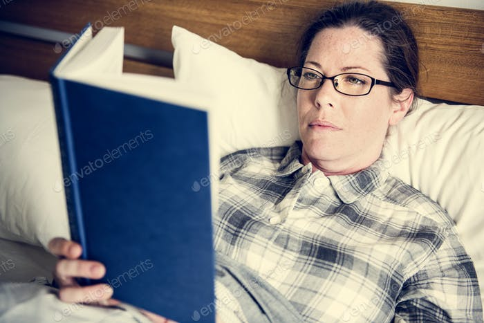 A woman reading in bed