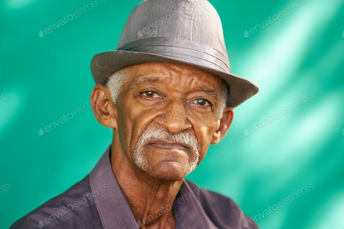 People Portrait Serious Elderly African American Man With Hat