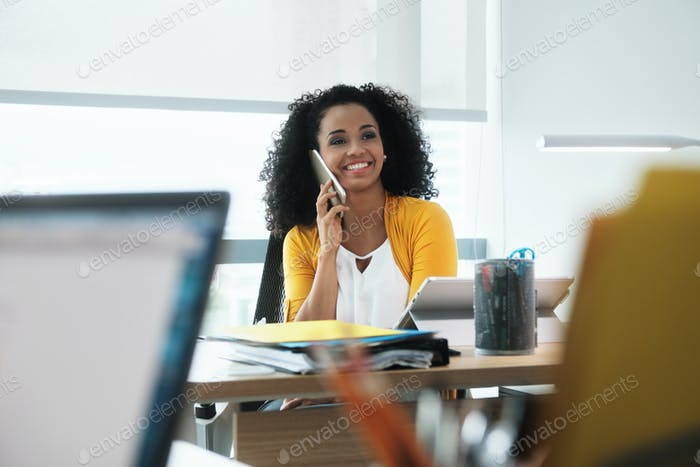 Beautiful Young Business Woman With Cell Phone In Corporate Office