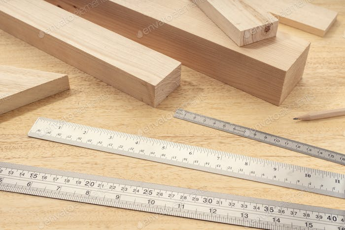 Group of assorted Wood material with professional rulers