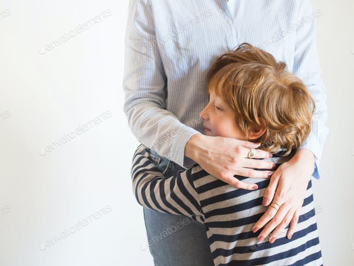 Young mother and child hugging. Mothers day