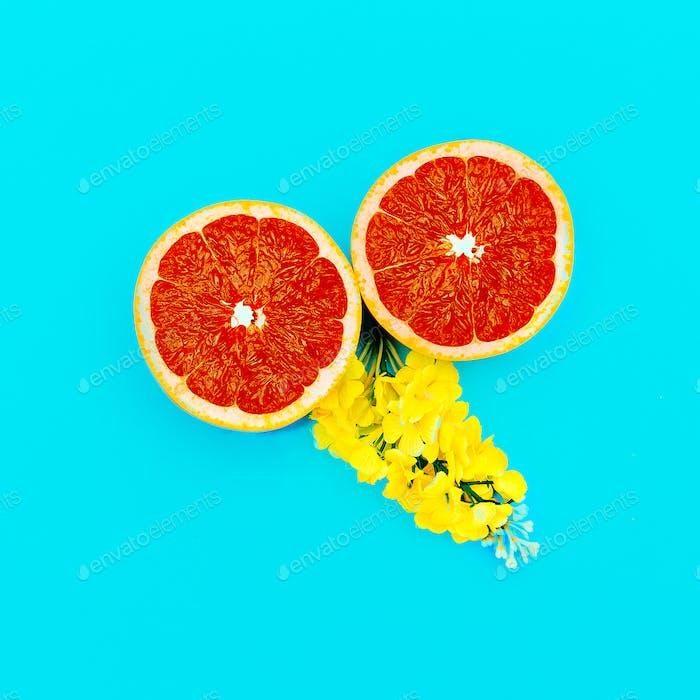 Grapefruit und Gelbe Blumen Minimale Kunst. Design