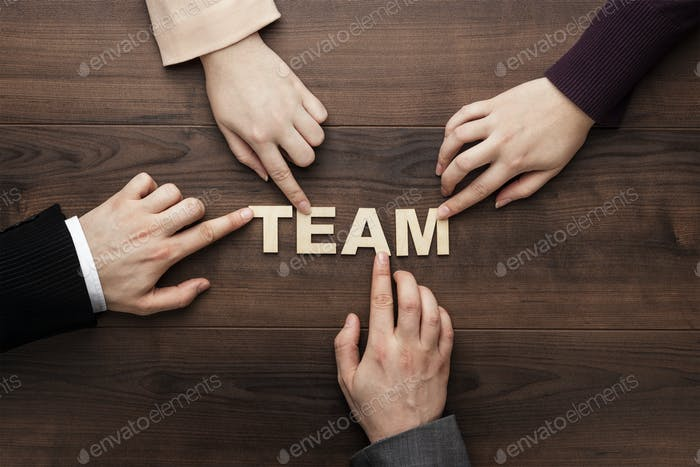 Team Concept On The Brown Wooden Table Background