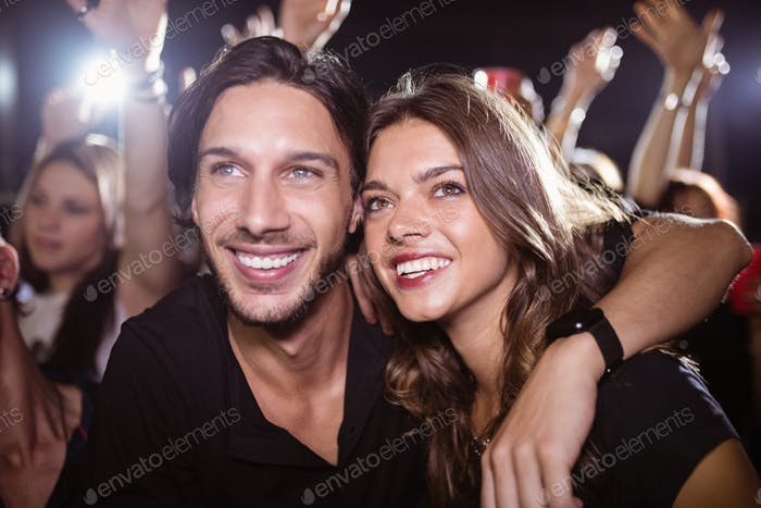 Thoughtful young friends enjoying at nightclub