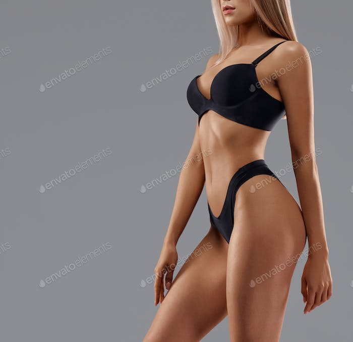 Female body in lingerie isolated on grey