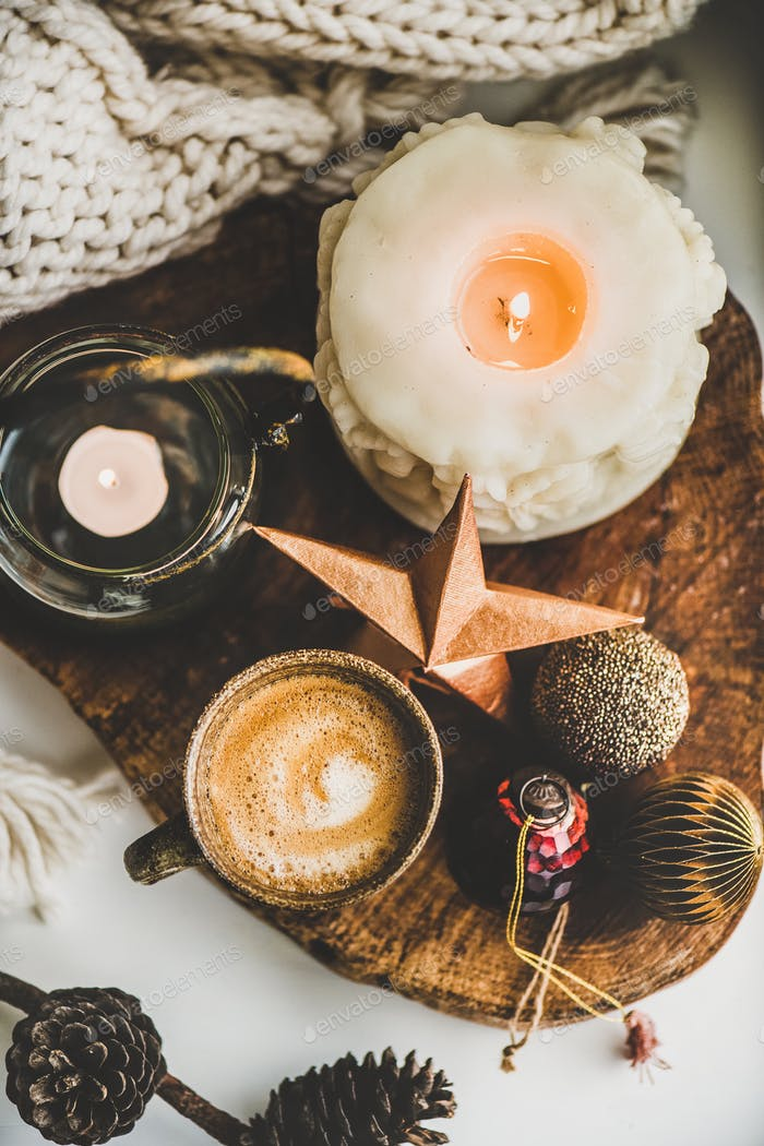 Flat-lay of Christmas composition with coffee, candles and decorative toys