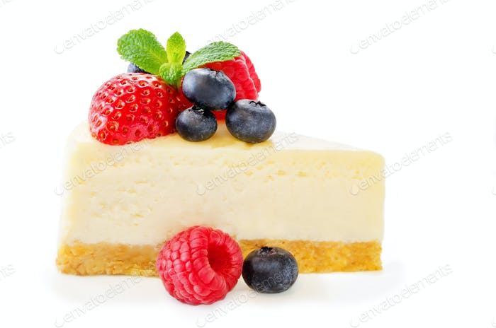 Cheesecake with fresh berries and mint leaves isolated