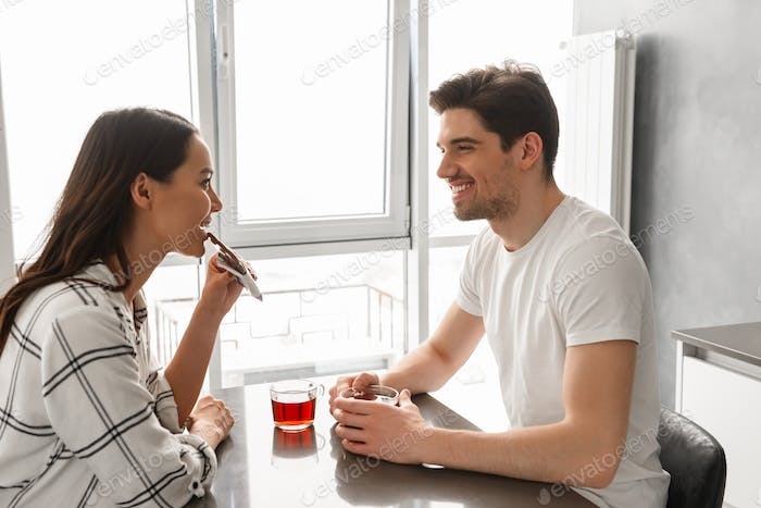 Image of attractive man and woman looking at each other, while s