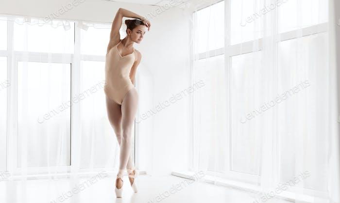 Beautiful Ballerina Standing On Tiptoe In Dance Class